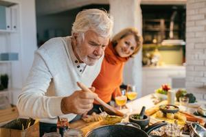 older people cooking together - image for cholesterol food fact sheet